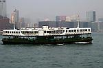 Hong Kong urban scene - HK Star Ferry moves across the bay.