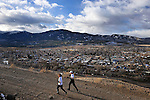 Cindy Stonesmith, left, and Jen Orr jog up Spiral Drive above the town of Salida. Michael Brands for The New York Times.