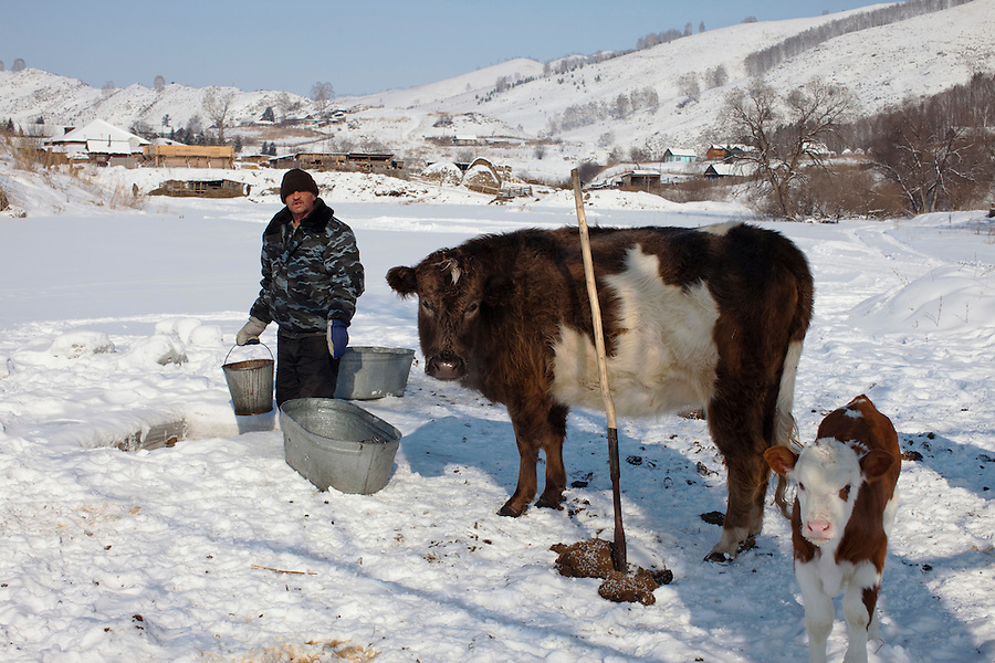 Altai Region, Siberia, Russia, 25/02/2011..A man draws water from a frozen lake in a village settlement near the proposed Siberian Coin casino project in the Altai mountains.