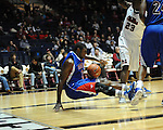 SMU's Leslee Smith (3) is fouled by Ole Miss' Reginald Buckner (23) at the C.M. &quot;Tad&quot; Smith Coliseum in Oxford, Miss. on Tuesday, January 3, 2012. Ole Miss won 50-48.