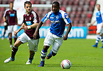 Hearts v St Johnstone...04.08.12.Nigel Hasselbaink and Scott Robinson.Picture by Graeme Hart..Copyright Perthshire Picture Agency.Tel: 01738 623350  Mobile: 07990 594431