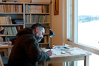 "Brother Joël writing a letter in the study. ..The new Munkeby Mariakloster - kloster is Norwegian for monastery . The four founding French monks will establish their discrete presence as a contemplative monastery according to the Rule of Saint Benedict, written in the 6th century. Brother Joel (55) & Cîteaux's Prior, brothers Arnaud (31), Bruno (33) and Cyril (81), have all chosen to be part of the founding community, despite Norway's rude climate and winter darkness at latitude 63º N, not far from the arctic circle.Munkeby, the ""place of the monks"" was the third and northernmost Norwegian monastery established by the Cistercians in the 12th century"