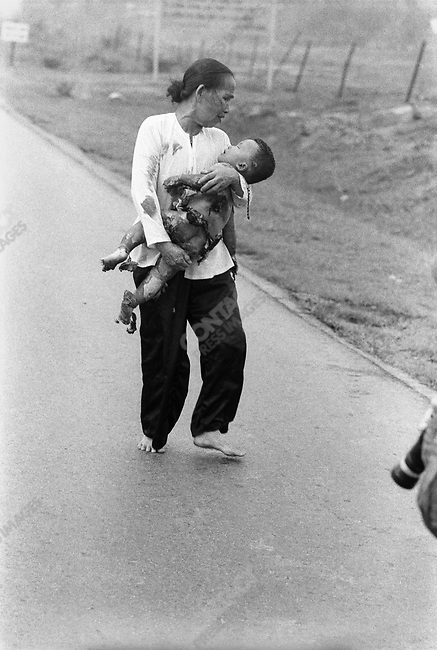 Civilians flee after an accidental napalm bombing during a battle in Trang Bang. Children and adults burned by the attack run down the road, away from the town, to try and get help. Trang Bang, South Vietnam, June 8, 1972