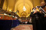 An Egyptian Coptic cleric leads prayer over the coffins of the victims of sectarian violence during an October 10, 20011 funeral  at the Coptic Cathedral  Cairo, Egypt. At least 26 people, mostly Christian, were killed during sectarian clashes that saw the worst violence since the Revolution that toppled former Egyptian president Hosni Mubarak earlier this year. Egyptian Coptic Christians make up about 10% of Egypt's 80 million population and periodically violence flares between the Christian minority and the majority Muslim population. (Photo by Scott Nelson)
