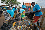 Women collect garbage inside a camp for internally displaced families located inside a United Nations base in Juba, South Sudan. The camp holds Nuer families who took refuge there in December 2013 after a political dispute within the country's ruling party quickly fractured the young nation along ethnic and tribal lines. The ACT Alliance is providing a variety of services, including fresh water, sanitation and refuse collection services, to the more than 20,000 people living in the camp.