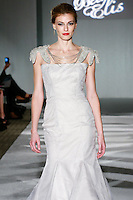 Model walks the runway in a Beth Elis Corona wedding dress by Nere Emiko during the Wedding Trendspot Spring 2011 Press Fashion, October 17, 2010.