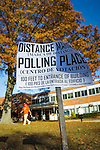 Merrick, New York, USA. Nov. 11, 2016. On Election Day, residents come from, and go to, to Polling Place to vote for President and state and local officials. Distance Marker sign on wooden post states, in English and Spanish, that it is 100 feet to Entrance of Polling Place building.
