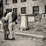 A couple looks at some of the gravestones in the King's Chapel cemetery