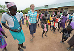 Loreto Sister Orla Treacy dances with girls at the Loreto Secondary School in Rumbek, South Sudan.  Treacy is the school's principal. The school is run by the Institute for the Blessed Virgin Mary--the Loreto Sisters--of Ireland.