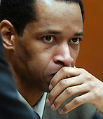Sniper suspect John Allen Muhammad listens during his trial at the Virginia Beach Circuit Court on Wednesday, October 22, 2003.  Muhammad is suffering from a cronic toothache, and his right cheek is swollen. <br />  Credit: Davis Turner - Pool via CNP