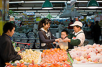 Mother and child buy vegetables in supermarket, Chongqing, China