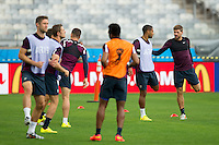 Steven Gerrard of England stretching during training