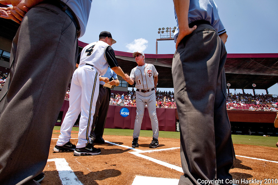 TALLAHASSEE, FL 6/12/10-FSU-VANDY BASE10 CH-Florida State Head Coach Mike Martin, center greets Vanderbilt Head Coach Tim Corbin Saturday during NCAA Super Regional action at Dick Howser Stadium in Tallahassee. The Commodores beat the Seminoles 6-2 to stay alive for game three...COLIN HACKLEY PHOTO