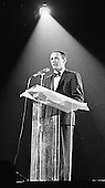 "Joey Bishop introduces an act during the Inaugural Gala honoring United States President-elect John F. Kennedy at the National Guard Armory in Washington, D.C. on January 19, 1961..Credit: Benjamin E. ""Gene"" Forte / CNP"