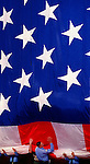 It's all hands on as color guards team up to gather up what is billed as the world's largest flying indoor American flag during a Memorial Day ceremony at the Crystal Cathedral, Sunday morning in Garden Grove..