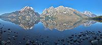 Jenny Lake Panorama, Grand Teton Mountain Reflections in the calm water of Jenny Lake in Grand Teton National Park.