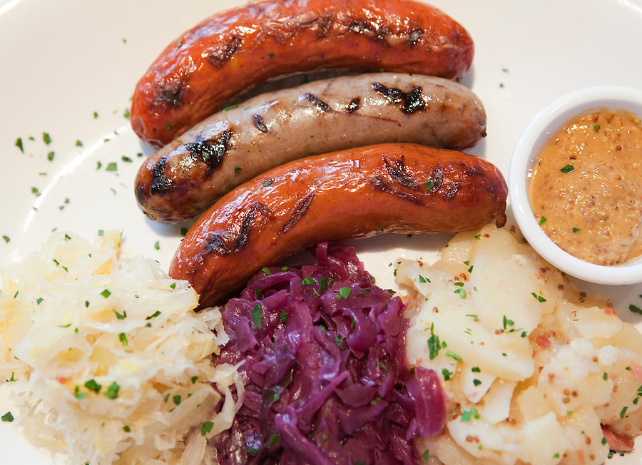 Gustav's, German restaurant in Clackamas outside of Portland. Three links of Wurst, German Bratwurst, smokes German Beir Wurst, and Sweet wild Boar Sausage served with warm potato salad, sauerkraut, red cabbage and whole grain mustard.