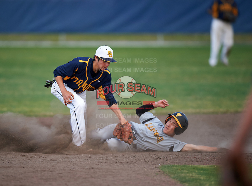 Boca Ciega Pirates second baseman Kaemic Brown (1) stretches for a throw as Jaime Robles (24) slides in during a game against the Lakeland Spartans at Boca Ciega High School on March 2, 2016 in St. Petersburg, Florida.  Boca Ciega defeated Lakewood 2-1.  (Mike Janes/Four Seam Images)