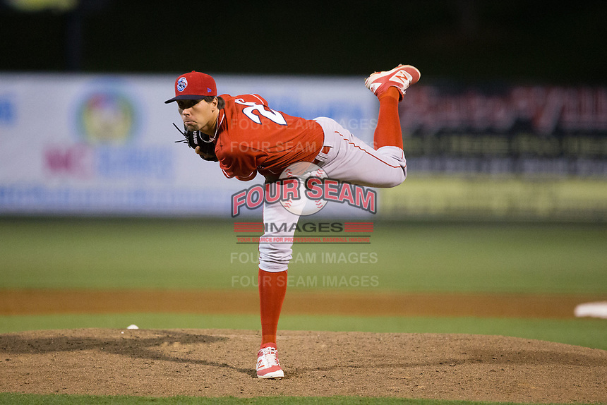 Lakewood BlueClaws relief pitcher Jonathan Hennigan (28) follows through on his delivery against the Kannapolis Intimidators at Kannapolis Intimidators Stadium on April 7, 2017 in Kannapolis, North Carolina.  The BlueClaws defeated the Intimidators 6-4.  (Brian Westerholt/Four Seam Images)