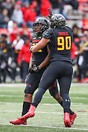 College Park, MD - November 26, 2016: Maryland Terrapins linebacker Jermaine Carter Jr. (23) and Maryland Terrapins defensive lineman Roman Braglio (90) celebrates during game between Rutgers and Maryland at  Capital One Field at Maryland Stadium in College Park, MD.  (Photo by Elliott Brown/Media Images International)