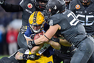 Baltimore, MD - DEC 10, 2016: Navy Midshipmen quarterback Zach Abey (9) is tackled by a host of Army Black Knights lead by linebacker Alex Aukerman (21) during game between Army and Navy at M&T Bank Stadium, Baltimore, MD. (Photo by Phil Peters/Media Images International)