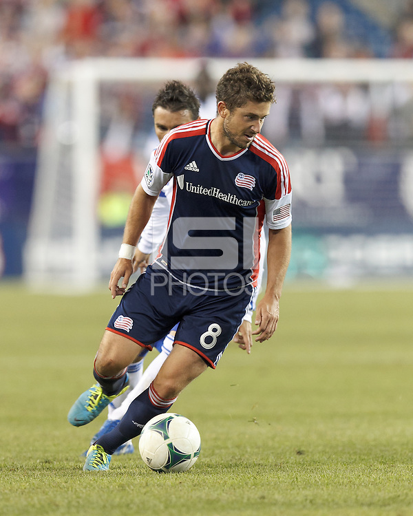 New England Revolution defender Chris Tierney (8) works to clear ball. In a Major League Soccer (MLS) match, Montreal Impact (white/blue) defeated the New England Revolution (dark blue), 4-2, at Gillette Stadium on September 8, 2013.