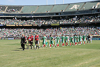 Mexico and Nicaragua players walk onto the field. Mexico defeated Nicaragua 2-0 during the First Round of the 2009 CONCACAF Gold Cup at the Oakland, Coliseum in Oakland, California on July 5, 2009.