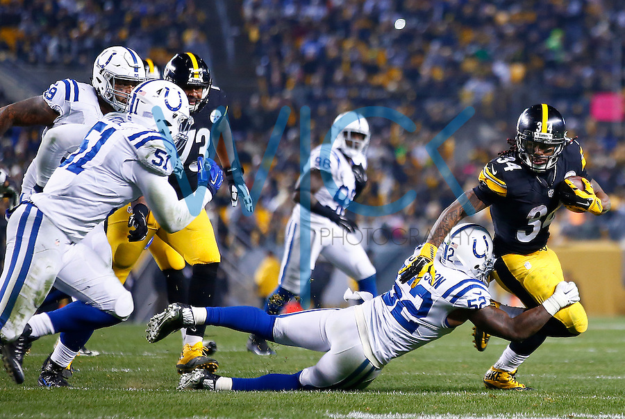 DeAngelo Williams #34 of the Pittsburgh Steelers runs with the ball through a tackle by D'Qwell Jackson #52 of the Indianapolis Colts in the first half during the game at Heinz Field on December 6, 2015 in Pittsburgh, Pennsylvania. (Photo by Jared Wickerham/DKPittsburghSports)