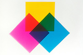 An overlap of square corners of the three primary dye colors, cyan, magenta, and yellow. All three dyes combine to form black theoretically ,center triangle,, but complete color subtraction is never perfect.