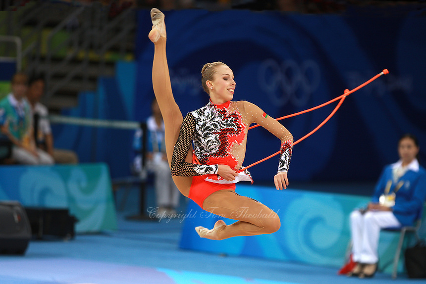 August 23, 2008; Beijing, China; Rhythmic gymnast Inna Zhukova of Belarus cossack leaps with rope on way to winning silver in the All-Around final at 2008 Beijing Olympics..