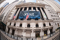 New York Stock Exchange workers remove the banner for the initial public offering of the technology company Yext on Thursday, April 13, 2017. The New York based Yext provides a cloud-based technology that enables companies to manage their listings across various search engines.  (© Richard B. Levine)