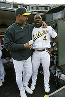 OAKLAND, CA - AUGUST 1:  Terry Francona and Miguel Tejada at the Network Assoc. Colisieum on August 1, 2003 in Oakland, Calif. The Athletics defeated the Yankees 3-2, in 10 innings. ....(Photo by Michael Zagaris/MLB Photos)