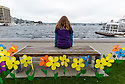 WA11159-00...WASHINGTON - Flowers on the shore of lake Union to remeber thoes who have Alzheimers.