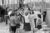 "Kids at the ""Venchie"" (adventure playground) site, Wester Hailes, Scotland, 1979.  John Walmsley was Photographer in Residence at the Education Centre for three weeks in 1979.  The Education Centre was, at the time, Scotland's largest purpose built community High School open all day every day for all ages from primary to adults.  The town of Wester Hailes, a few miles to the south west of Edinburgh, was built in the early 1970s mostly of blocks of flats and high rises."