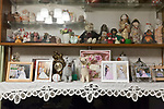 framed family photographs and dolls display at home Japan