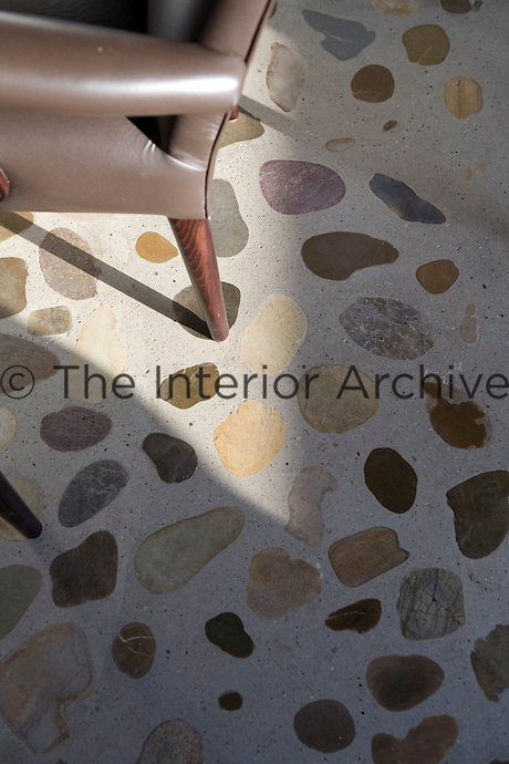 A detail of the concrete flooring at the Hotel Aire de Bardenas inlaid with pebbles