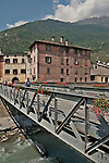 A bridge that crosses the River Adda and links the old medieval town to the new town in Tirano, Italy; you can see the vineyards of the Valtellina Valley in the background