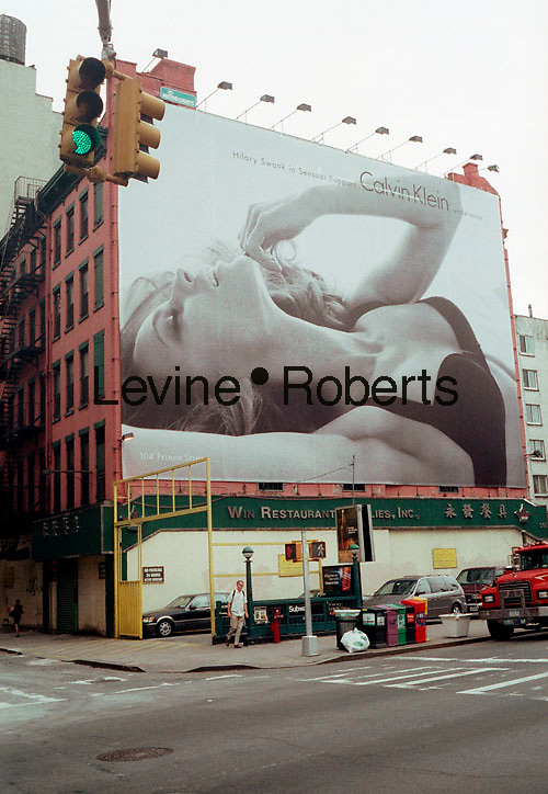 A billboard featuring the actress Hilary Swank for Calvin Klein Sensual Support towers above Houston Street in Lower Manhattan on August 10, 2004.  Klein ads have been controversial in the past using sex to sell his clothing with near-naked men and women in situations reminiscent of pornography. (© Richard B. Levine)