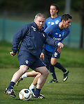 Ally McCoist getting stuck in with his players at training