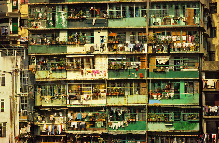 Hong Kong, China. Crowded tenement block of apartments with balconies.  Mon Kok. Kowloon.