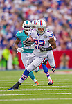 14 September 2014: Buffalo Bills running back Fred Jackson runs for yardage against the Miami Dolphins at Ralph Wilson Stadium in Orchard Park, NY. The Bills defeated the Dolphins 29-10 to win their home opener and start the season with a 2-0 record. Mandatory Credit: Ed Wolfstein Photo *** RAW (NEF) Image File Available ***