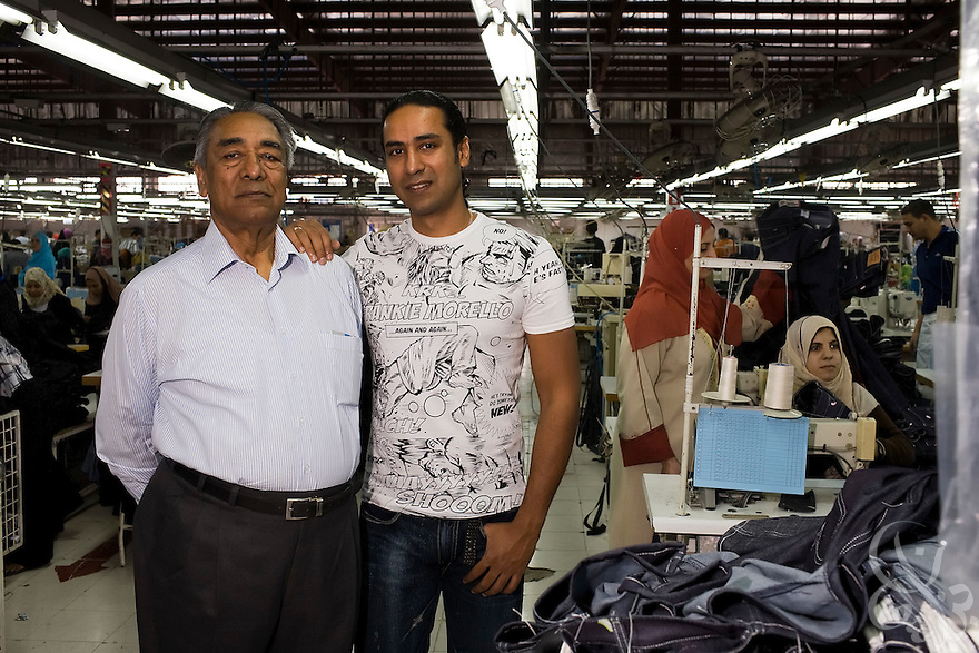 Air Marshal Man Mohan Sinha, chairman of Velocity Apparelz CO (l) poses for a photograph with his son, and CEO of parent company Vogue International Agencies FZE, Siddharth Sinha  October 27, 2008 on the production floor at the Velocity factory in Ismailia (130 kilometers north of Cairo, Egypt.)  The Sinhas are Indian businessmen who have been operating their jeans company in Egypt since 2001, employing 2700 Egyptian workers while supplying jeans to major companies that include Levis, Target, and Zara.