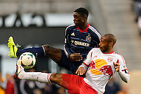 Thierry Henry (14) of the New York Red Bulls battles for the ball with Jalil Anibaba (6) of the Chicago Fire during a Major League Soccer (MLS) match at Red Bull Arena in Harrison, NJ, on October 27, 2013.