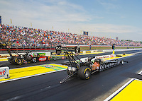 May 17, 2015; Commerce, GA, USA; NHRA top fuel driver Dave Connolly (near lane) races alongside Terry McMillen during the Southern Nationals at Atlanta Dragway. Mandatory Credit: Mark J. Rebilas-USA TODAY Sports