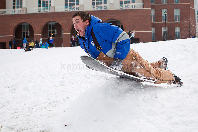"""Ben Connor sleds over a ramp in """"the Bowl"""" outside the William T. Young Library in Lexington, Ky., on Monday, February 3, 2014. Photo by Emily Wuetcher  