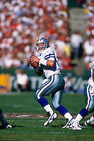 SAN FRANCISCO, CA - Quarterback Troy Aikman of the Dallas Cowboys in action during a game against the San Francisco 49ers at Candlestick Park in San Francisco, California in 1997. Photo by Brad Mangin