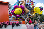 Vendors sell balloons in Gorky Park on Saturday, August 17, 2013 in Moscow, Russia.