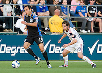 Ramiro Corrales of Earthquakes dribbles the ball away from Ned Grabavoy of Real Salt Lake during the game at Buck Shaw Stadium in Santa Clara, California on March 27th, 2010.   Real Salt Lake defeated San Jose Earthquakes, 3-0.