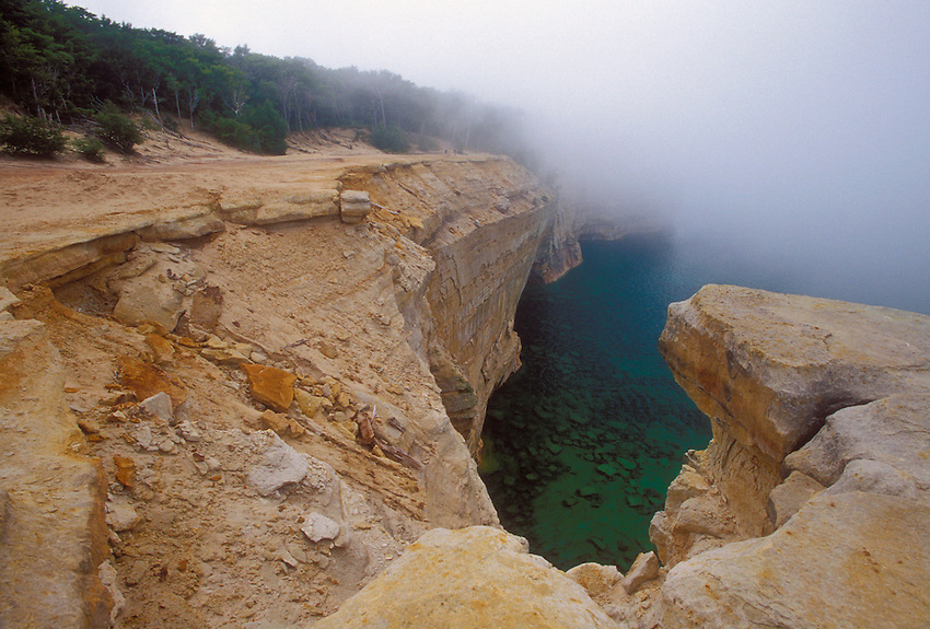 The cliffs of Pictured Rocks National Lakeshore near Munising, Mich. in the fog.