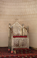 Detail of gilded throne, Kurinish Khana or Throne Room, 1804-06, Kukhna Ark, Khiva, Uzbekistan, pictured on July 6, 2010, in the afternoon. The Kukhna Ark is the original home of the Khans. Although its foundations are 5th century, most of the complex is 19th century. Khiva, ancient and remote, is the most intact Silk Road city. Ichan Kala, its old town, was the first site in Uzbekistan to become a World Heritage Site(1991). Picture by Manuel Cohen.